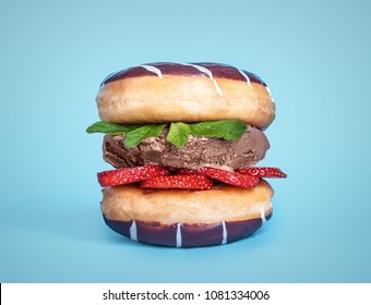 two donuts, chocolate ice cream, srawberry with mint in sandwich on blue background