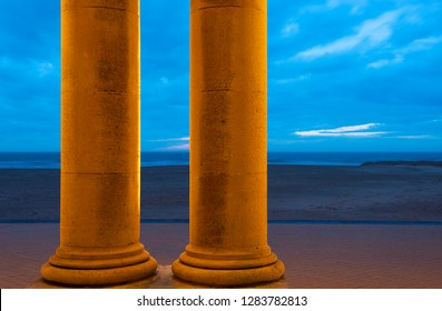 Two doric columns of the Venitian Gallery by the Waterfront of Ostend city, the North Sea Beach and waterfront, Belgium.