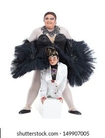Two drag queens performing together in humorous caricature of women, on white