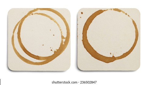 Two Drink Coasters with Coffee Stains Isolated on White Background.