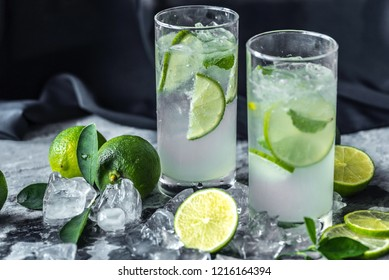 Two drinking glass with lemon beverages