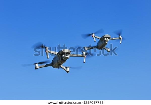 Two drones in flight