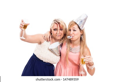 Two drunken girls celebrate with alcohol, isolated on white background