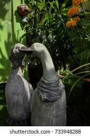 Two duck-shaped stucco put in the garden and light to shine.
