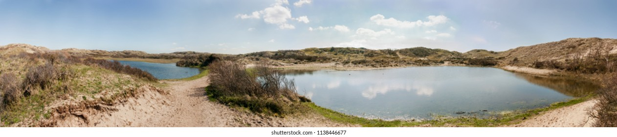 Two dune lakes in the North Holland Dune Reserve - panorama. Dune lakes in the inland dunes at Egmond aan Zee, the Netherlands