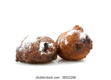 two Dutch donut also known as oliebollen, traditional New Year's eve food isolated on white background