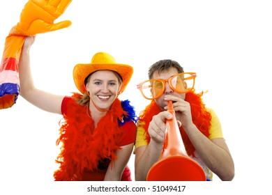 two Dutch soccer fans in orange outfit with accessories over white background