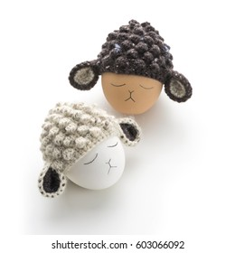 two easter eggs with crochet lamb hat