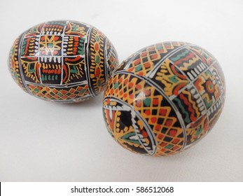 Two Easter eggs on a white background.