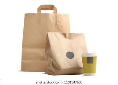 Two eco package and a glass of coffee isolated on white background. Concept packaging of meals.