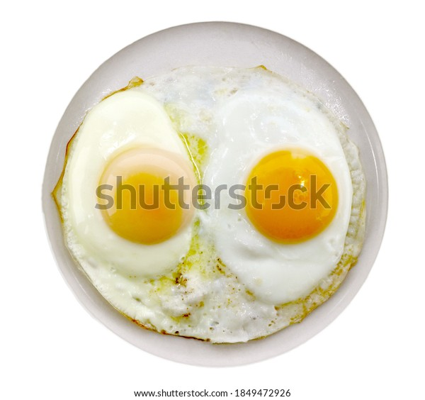 Two eggs cooked sunny side up.