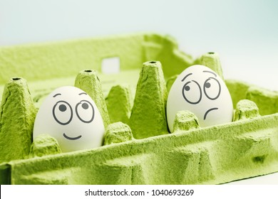 Two eggs in eggbox. Optimist and pessimist
