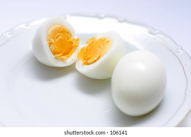 two eggs, one cut in half