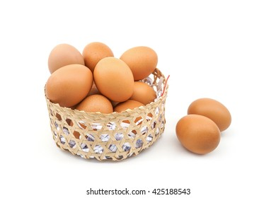 two eggs out of basket isolated on white background