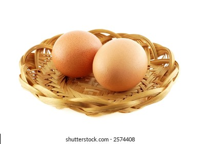 Two eggs in a wicker dish