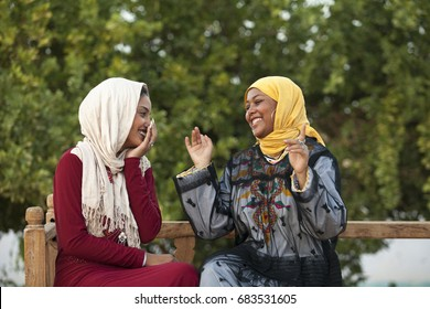 two Egyptian girl talking with each other