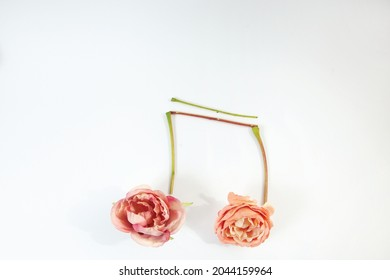Two eight notes made of roses and fresh sticks, music symbol, creative - Shutterstock ID 2044159964