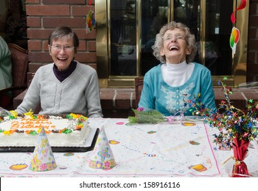 Two elderly residents at an assisted living facility celebrate their birthdays
