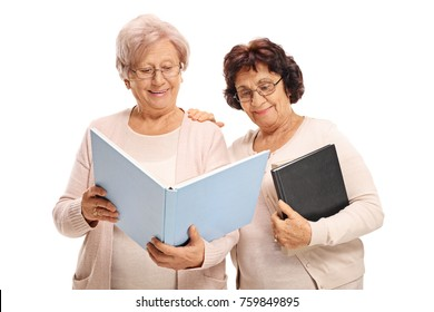 Two elderly women reading a book isolated on white background