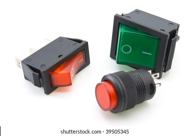two electric switches and one red button on a white background