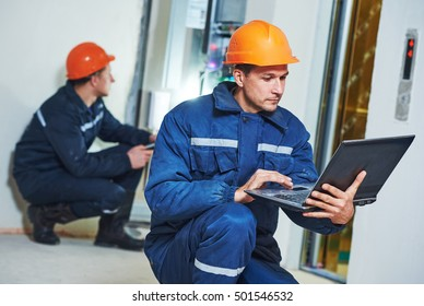 Two electrician works with electronic equipment