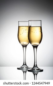 Two elegant glasses with sparkling champagne Holiday card Christmas, New Year, wedding. Celebration concept advertising design