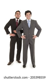 two elegant men in suits posing with hands on hips isolated on white