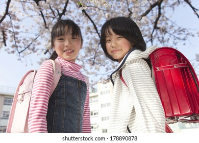 Two elementary girls smiling back