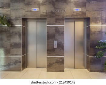 Two elevators in hotel lobby