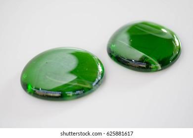 Two emerald color decorative stone