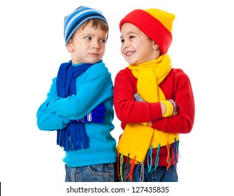 Two emotional kids in winter clothes showing a different emotions, isolated on white