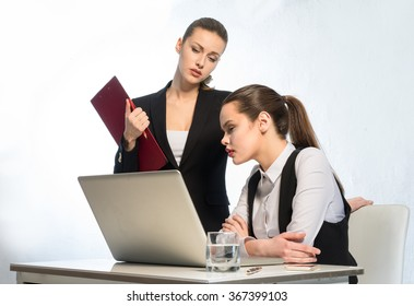 Two employee working at a laptop