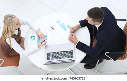 two employees discussing financial charts