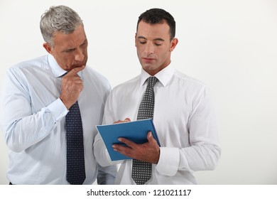 Two employees going over contract