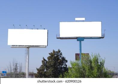 Two empty billboards near the road