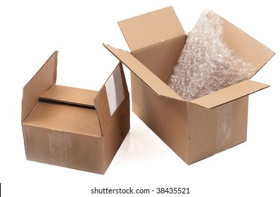 Two empty cardboard boxes with bubble wrap on white