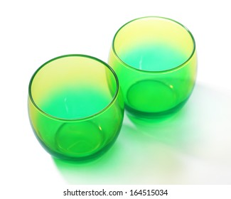 Two empty color  glasses, isolated on white