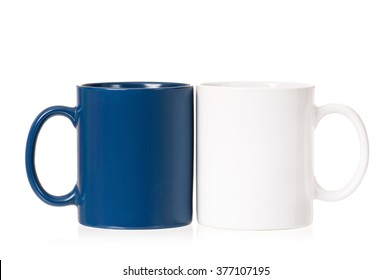 Two empty cups for coffee or tea, isolated on white background