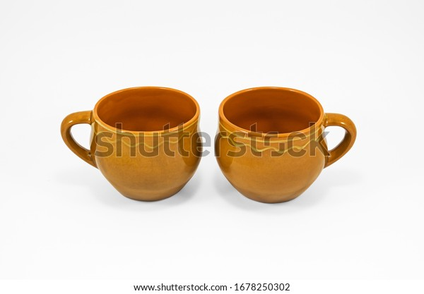 two-empty-homemade-clay-cups-600w-167825