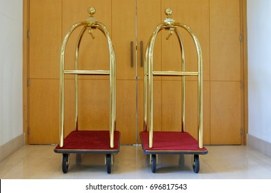 Two empty luggage carts in a hotel hallway. Hospitality industry  background