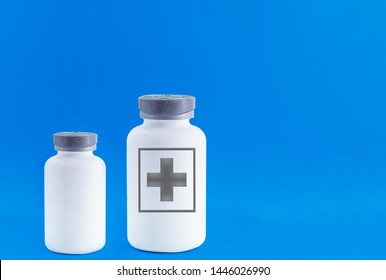 Two empty pill bottles. Beautiful blue background, modern medicine used for disease prevention and treatment, copies the space.