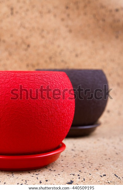 two empty, red and brown flower pot on the wooden background