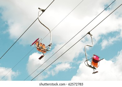 Two empty ski lifts