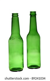 Two empty transparent green beer bottles over white background/two empty bottles