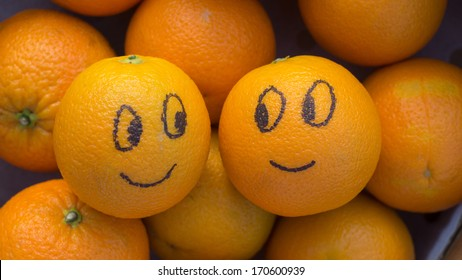 Two enamored oranges in a box