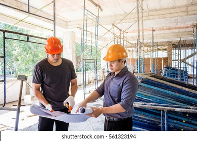 two engineer checking the construction site.
