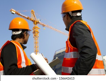 Two engineer construction. Site manager with safety vest discussion under construction