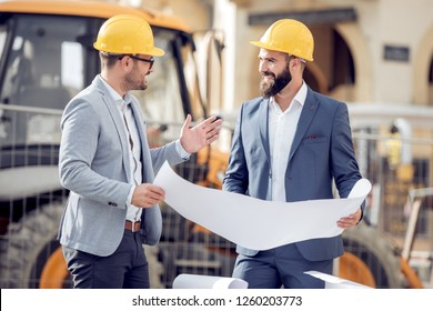 Two engineer have consulting meeting at construction site.