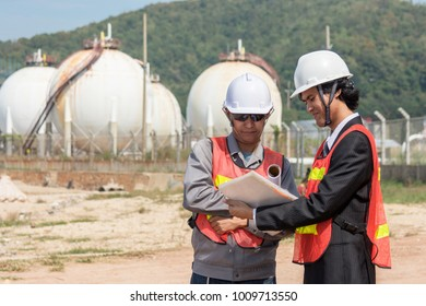Two engineer on site with oil refinery