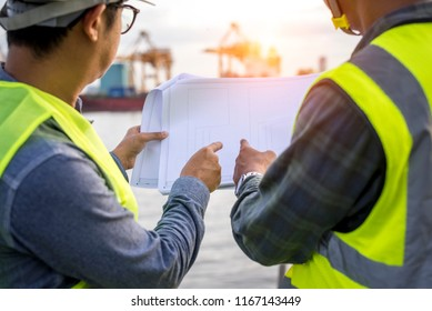 Two engineering port checking scheduled ship at cargo port